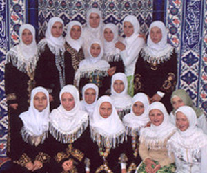 Girls from the village of Ribnovo, in Saudi Arabian attire, are pictured after taking a class on radical Islam. Photo by  BGNES